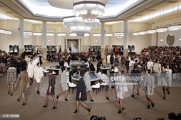 Models present creations for Chanel during the 20152016 fall/winter Haute Couture collection fashion show on July 7 2015 at the Grand Palais in Paris...