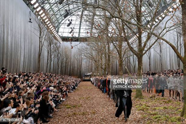 Models present creations for Chanel during the 2018/2019 fall/winter collection fashion show on March 6, 2018 at the Grand Palais in Paris.
