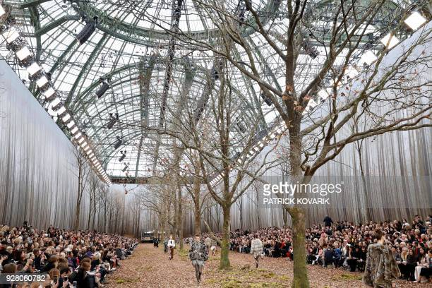 Models present creations for Chanel during the 2018/2019 fall/winter collection fashion show on March 6 2018 at the Grand Palais in Paris