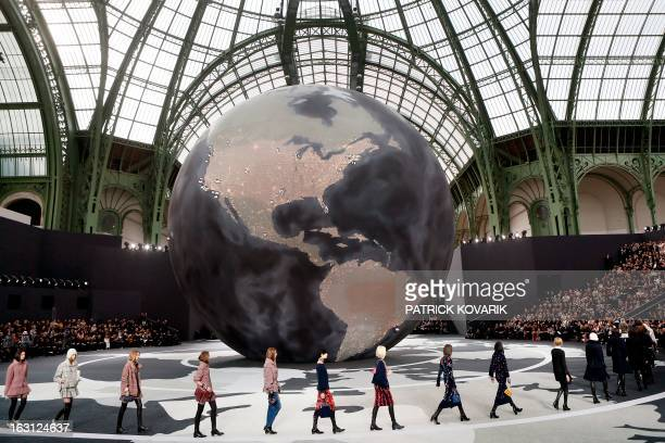 Models present creations for Chanel during the Fall/Winter 2013-2014 ready-to-wear collection show, on March 5, 2013 at the Grand Palais in Paris....
