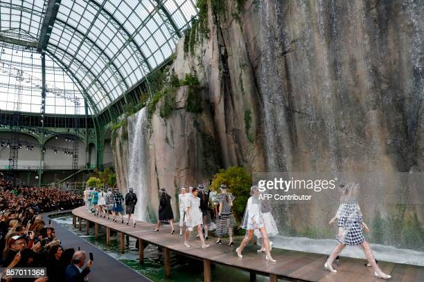 TOPSHOT Models present creations for Chanel during the women's 2018 Spring/Summer readytowear collection fashion show in Paris on October 3 2017 /...