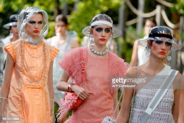 Models present creations for Chanel during the women's 2018 Spring/Summer readytowear collection fashion show in Paris on October 3 2017 / AFP PHOTO...