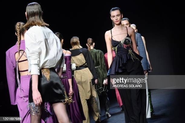 Models present creations for Chinese designer Han Wen's Fall Winter 2020 collection as part of the China We are With You fashion event kicking off...