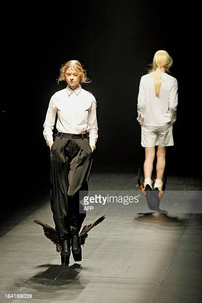 Models present creations for Christian Dada for the spring/summer 20132014 collection at Tokyo Fashion Week on March 18 2013 in Tokyo JAPAN OUT AFP...