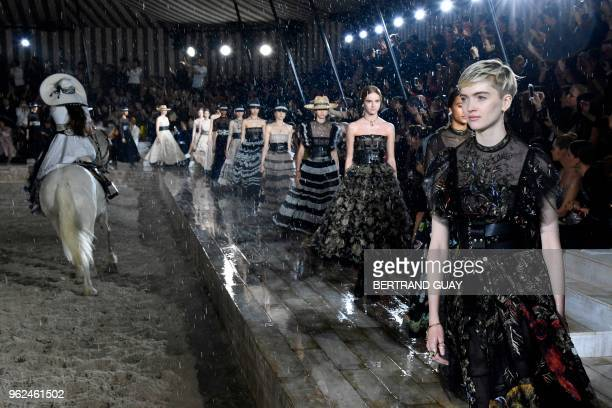 Models present creations for Dior during the 2019 Dior Croisiere fashion show on May 25 2018 at the Grandes écuries de Chantilly near Paris