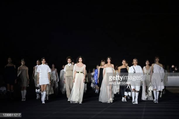 Models present creations for Dior during the 2022 Dior Croisiere fashion show, at the Panathenaic Stadium, in Athens, on June 17, 2021.