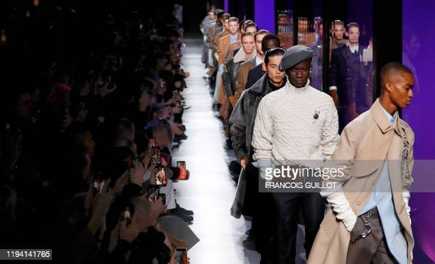 Models present creations for Dior Homme during the men's Fall/Winter 2020/2021 collection fashion show in Paris on January 17, 2020.