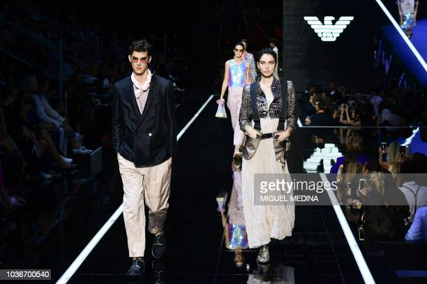 Models present creations for Emporio Armani fashion house during the Women's Spring/Summer 2019 fashion shows in Milan, on September 20, 2018.