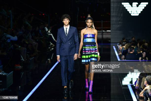 Models present creations for Emporio Armani fashion house during the Women's Spring/Summer 2019 fashion shows in Milan on September 20 2018