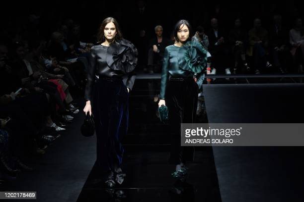Models present creations for Emporio Armani's Women Fall - Winter 2020 fashion collection on February 21, 2020 in Milan.