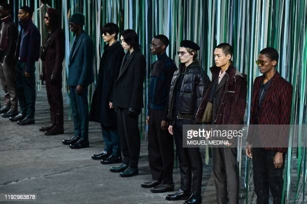 Models present creations for Ermenegildo Zegna during the men's fall/winter 2020/21 fashion collections in Milan on January 10, 2020.