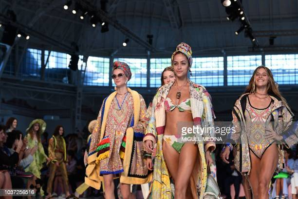 Models present creations for Etro fashion house during the Women's Spring/Summer 2019 fashion shows in Milan on September 21 2018