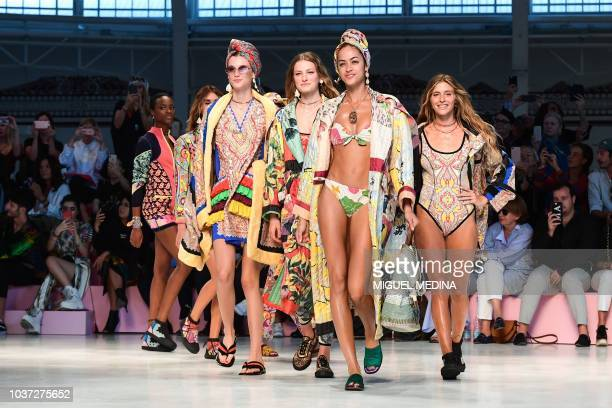 Models present creations for Etro fashion house during the Women's Spring/Summer 2019 fashion shows in Milan, on September 21, 2018.