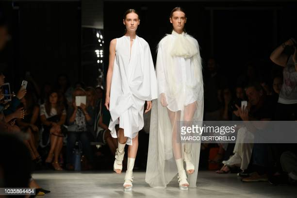 Models present creations for fashion house Alberto Zambelli during the Women's Spring/Summer 2019 fashion shows in Milan on September 19 2018