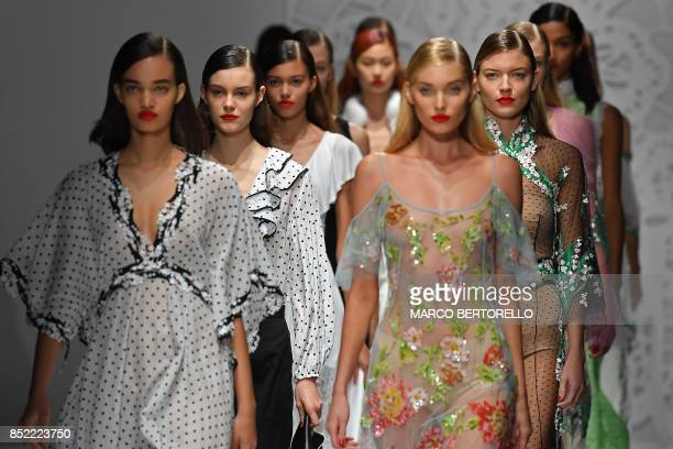 Models present creations for fashion house Blumarine during the Women's Spring/Summer 2018 fashion shows in Milan on September 23 2017