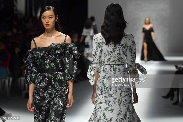 Models present creations for fashion house Blumarine during the Women's Spring/Summer 2018 fashion shows in Milan on September 23 2017 / AFP PHOTO /...
