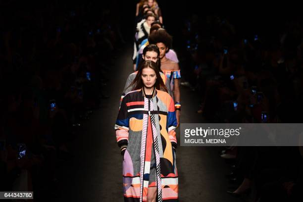Models present creations for fashion house Byblos during the Women's Fall/Winter 2017/2018 fashion week in Milan on February 23 2017 / AFP / Miguel...