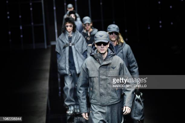 TOPSHOT Models present creations for fashion house Emporio Armani during its Men's Fall/Winter 2019/20 fashion show in Milan on January 14 2019