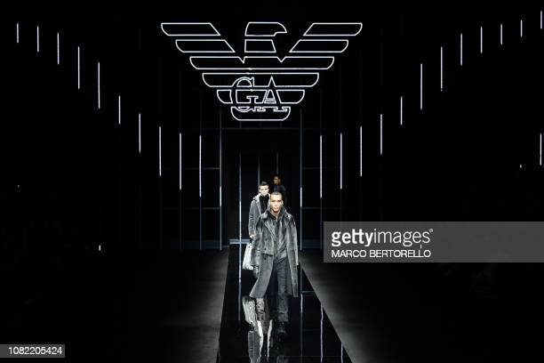 Models present creations for fashion house Emporio Armani during its Men's Fall/Winter 2019/20 fashion show in Milan on January 14 2019