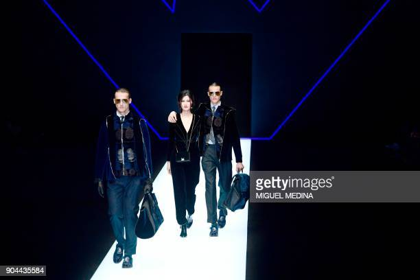 Models present creations for fashion house Emporio Armani during the Men's Fall/Winter 2019 fashion shows in Milan on January 13 2018 / AFP PHOTO /...