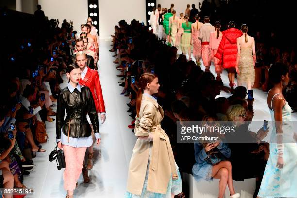 Models present creations for fashion house Ermanno Scervino during the Women's Spring/Summer 2018 fashion shows in Milan on September 23 2017 / AFP...
