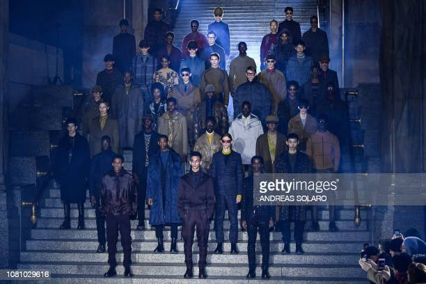 Models present creations for fashion house Ermenegildo Zegna during the Men's Fall/Winter 2019/20 fashion shows in Milan on January 11 2019