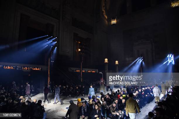 Models present creations for fashion house Ermenegildo Zegna during the Men's Fall/Winter 2019/20 fashion shows in Milan's central railway station on...