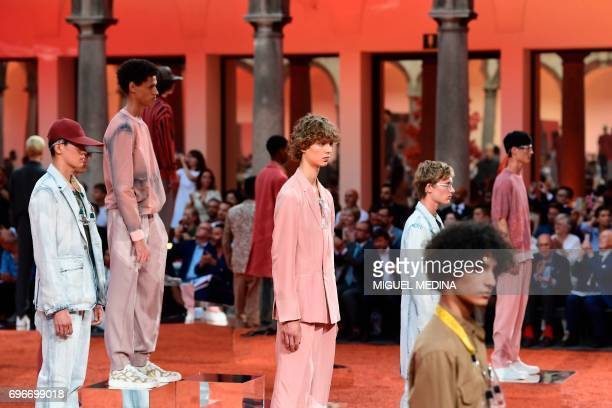 Models present creations for fashion house Ermenegildo Zegna during the Men's Spring/Summer 2018 fashion shows in Milan on June 16 2017 / AFP PHOTO /...