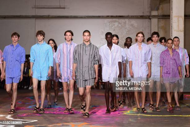 Models present creations for fashion house Etro during the presentation of its men's spring/summer 2020 fashion collection in Milan on June 16 2019