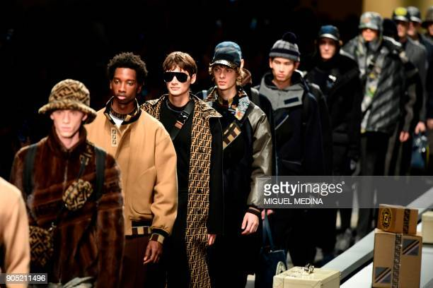 Models present creations for fashion house Fendi during the Men's Fall/Winter 2019 fashion shows in Milan on January 15 2018 / AFP PHOTO / Miguel...