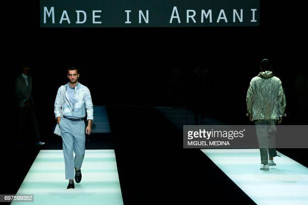 Models present creations for fashion house Giorgio Armani during the Men's Spring/Summer 2018 fashion shows in Milan on June 19 2017 / AFP PHOTO /...