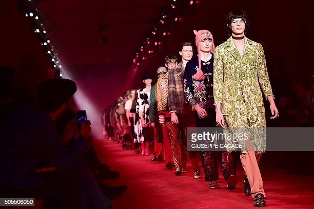 Models present creations for fashion house Gucci during the Men Fall Winter 2016 / 2017 collection shows at the Milan's Fashion Week on January 18...