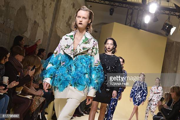 Models present creations for fashion house Marni as part of the Women Autumn / Winter 2016 Milan Fashion Week on February 28 2016 AFP PHOTO / TIZIANA...