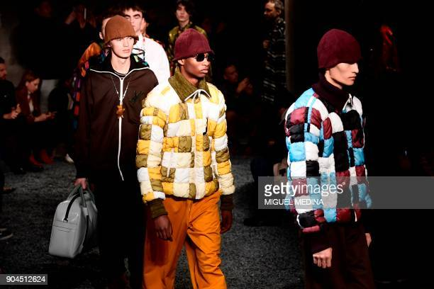 Models present creations for fashion house Marni during the Men's Fall/Winter 2019 fashion shows in Milan, on January 13, 2018. / AFP PHOTO / Miguel...