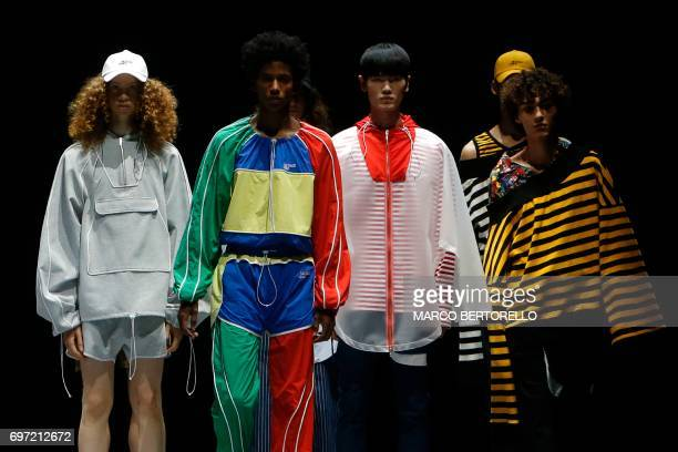 Models present creations for fashion house Munsoo Kwon during the Men's Spring/Summer 2018 fashion shows in Milan on June 18 2017 / AFP PHOTO / Marco...