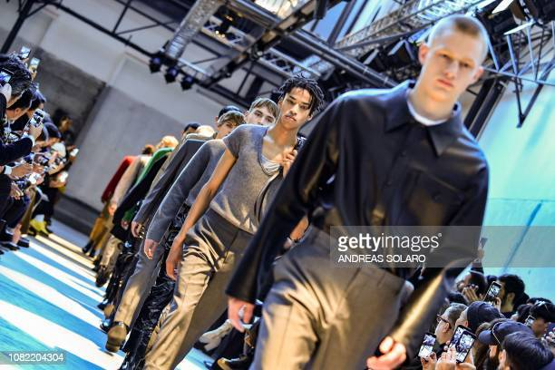 Models present creations for fashion house N21 during its Men's Fall/Winter 2019/20 fashion show in Milan on January 14 2019