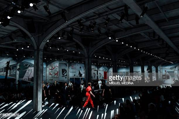 TOPSHOT Models present creations for fashion house Prada during the Men's Spring/Summer 2018 fashion shows in Milan on June 18 2017 / AFP PHOTO /...