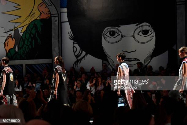 Models present creations for fashion house Prada during the Women's Spring/Summer 2018 fashion shows in Milan on September 21 2017 / AFP PHOTO /...