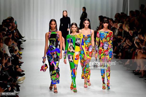 Models present creations for fashion house Versace during the Women's Spring/Summer 2018 fashion shows in Milan on September 22 2017 / AFP PHOTO /...