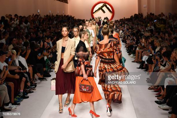 Models present creations for Fendi fashion house during the Women's Spring/Summer 2019 fashion shows in Milan on September 20 2018