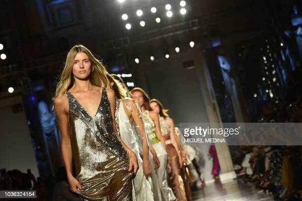 Models present creations for Genny fashion house during the Women's Spring/Summer 2019 fashion shows in Milan on September 20 2018