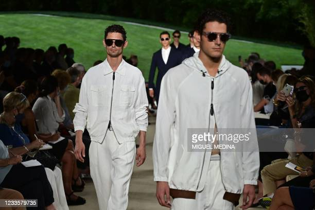 Models present creations for Giorgio Armani's Men's Spring Summer 2022 fashion collection on June 21, 2021 during the Milan Fashion Week.