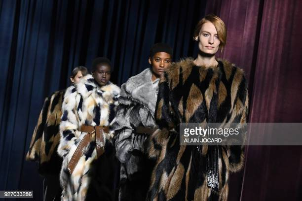 TOPSHOT Models present creations for Givenchy during the women's 2018/2019 fall/winter collection fashion show on March 4 2018 in Paris / AFP PHOTO /...