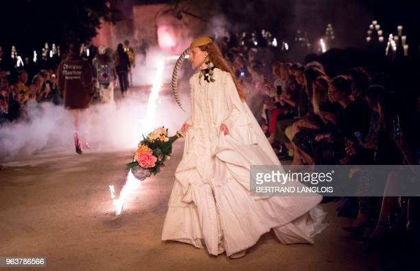 Models present creations for Gucci during the 2019 Gucci Croisiere collection fashion show on May 30 2018 at Alyscamps in Arles southeastern France