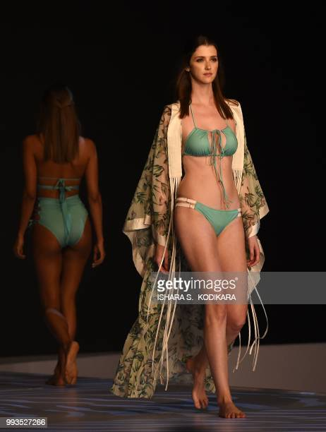 Models present creations for HAH at the 'Swim Week Colombo' fashion show in Colombo on July 7 2018 Swim week Colombo fashion show showcase designers...