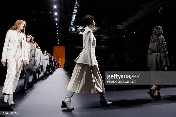 Models present creations for Hermes during the 20162017 fall/winter readytowear collection on March 7 2016 in Paris AFP PHOTO / FRANCOIS GUILLOT /...