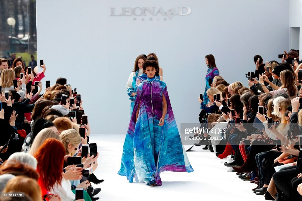 Models present creations for Leonard Paris during the 2018/2019 fall/winter collection fashion show on March 5, 2018 in Paris. /