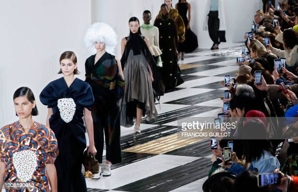 Models present creations for Loewe during the Women's Fall-Winter 2020-2021 Ready-to-Wear collection fashion show in Paris, on February 28, 2020.