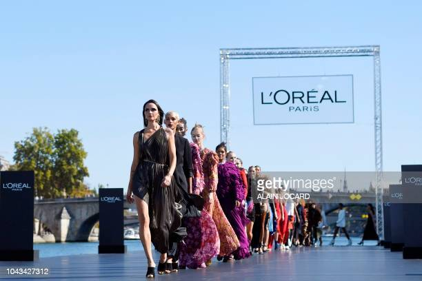 Models present creations for L'Oreal during the Spring-Summer 2019 Ready-to-Wear collection fashion show in Paris, on September 30, 2018.