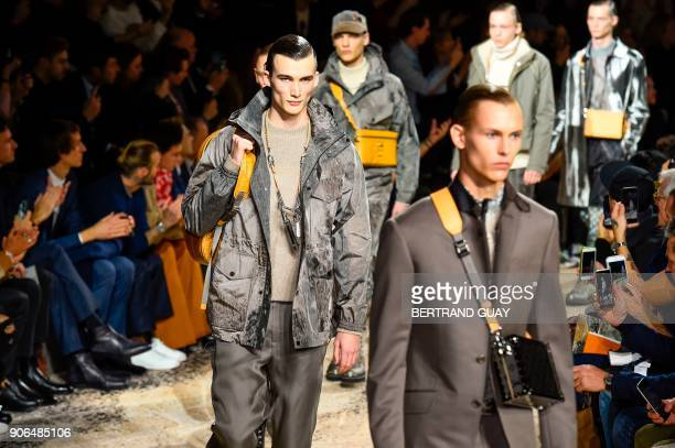 Models present creations for Louis Vuitton men's Fall/Winter 2018/2019 fashion show in Paris on January 18 2018 / AFP PHOTO / BERTRAND GUAY